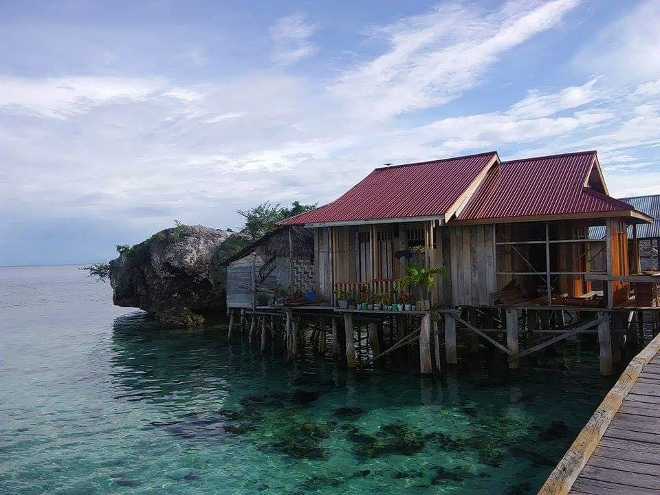 travel off the beaten path Togean traditional home